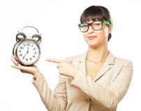 Businesswoman wearing glasses holding alarm clock Stock Image