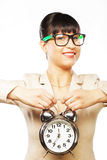 Businesswoman wearing glasses holding alarm clock Stock Photography