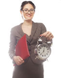 Businesswoman wearing glasses holding alarm clock Stock Images
