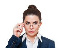 Businesswoman  wearing glasses looking at camera. Royalty Free Stock Photos