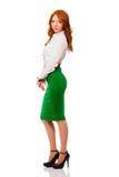 Businesswoman wearing green skirt Stock Photos