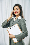 Businesswoman wearing grey suit standing Stock Images