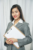 Businesswoman wearing grey suit standing Royalty Free Stock Photo