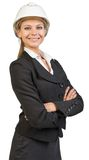 Businesswoman wearing hard hat, her arms crossed Stock Photos