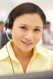 Businesswoman wearing headset. Smiling Stock Images