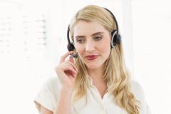 Businesswoman wearing headset in office Royalty Free Stock Images