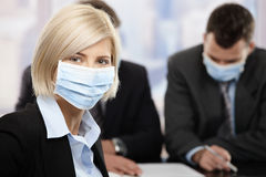 Businesswoman wearing mask royalty free stock photos