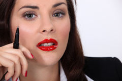 Businesswoman wearing red lipstick Stock Photo