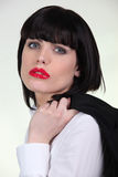 Businesswoman wearing red lipstick Stock Photography