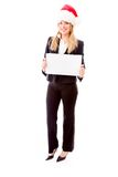 Businesswoman wearing Santa hat and holding a blank placard Royalty Free Stock Photos
