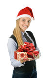 Businesswoman wearing a santa's hat with a gift Stock Photo