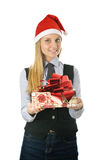 Businesswoman wearing a santa's hat with a gift Royalty Free Stock Image