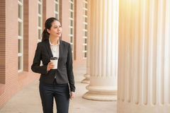Businesswoman wearing suit holding coffee Royalty Free Stock Photo