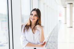 Portrait businesswoman wearing suit smile near Panoramic windows background. Businesswoman wearing suit smile near Panoramic windows background royalty free stock photo
