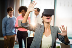 Businesswoman wearing virtual glasses. In office Royalty Free Stock Photos