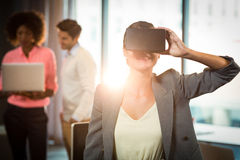 Businesswoman wearing virtual glasses. In office Stock Image
