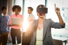 Businesswoman wearing virtual glasses. In office Stock Photos