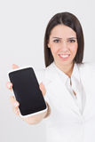 Businesswoman wearing white showing smart phone screen Stock Image