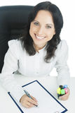 Businesswoman wearing white and smiling Royalty Free Stock Image