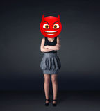 Businesswoman wears devil smiley face Stock Photography