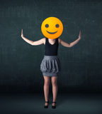 Businesswoman wears yellow smiley face Stock Photos