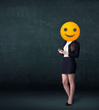 Businesswoman wears yellow smiley face Royalty Free Stock Photos