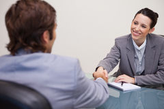 Businesswoman welcomes customer in her office Royalty Free Stock Image