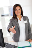 Businesswoman welcoming client Stock Image