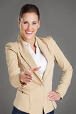 Businesswoman in welcoming pose Stock Photos