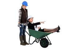 Businesswoman in a wheelbarrow royalty free stock photo