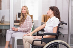Businesswoman in wheelchair listening to presentation Royalty Free Stock Photography