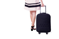 Businesswoman with wheeled travel bag makes step forward. Stock Photo