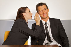 Businesswoman whispering Stock Image