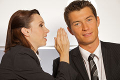 Businesswoman whispering Stock Photo