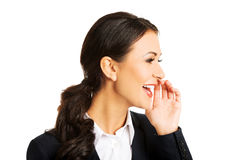 Businesswoman whispering to someone Stock Photo