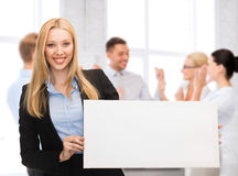 Businesswoman with white blank board Stock Photos