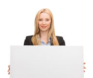 Businesswoman with white blank board Stock Image