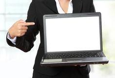 Businesswoman with white blank monitor Stock Photography