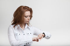 Businesswoman in white blouse, looking at her Stock Images