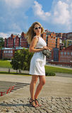 Businesswoman in white dress. The young businesswoman in white dress in the city Stock Photo