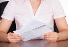 Businesswoman with white envelope Stock Photos
