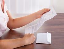 Businesswoman with white envelope Stock Photos