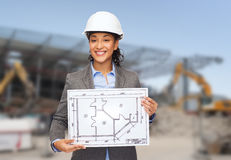 Businesswoman in white helmet with blueprint Royalty Free Stock Photos