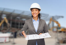 Businesswoman in white helmet with blueprint Royalty Free Stock Photo