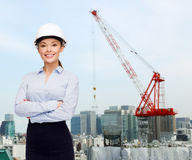 Businesswoman in white helmet Royalty Free Stock Images