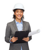 Businesswoman in white helmet with clipboard Stock Images