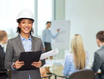 Businesswoman in white helmet with clipboard Stock Photos