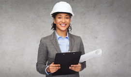 Businesswoman in white helmet with clipboard Royalty Free Stock Image