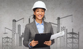 Businesswoman in white helmet with clipboard Royalty Free Stock Photography