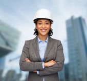 Businesswoman in white helmet with crossed arms Stock Images
